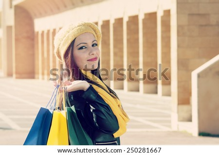 beautiful girl with shopping bag rejoices happy for purchases filter applied instagram style and a flare effect added - stock photo