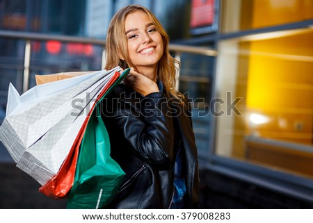 beautiful girl with shopping bags in ctiy. - stock photo