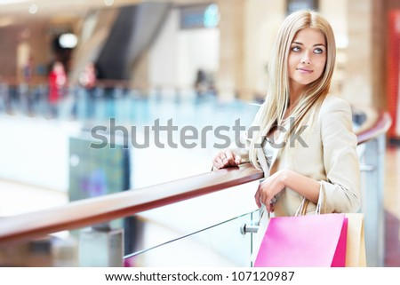 Beautiful girl with shopping bags in store - stock photo