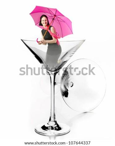 Beautiful  girl with umb?ella  in Martini glass - stock photo