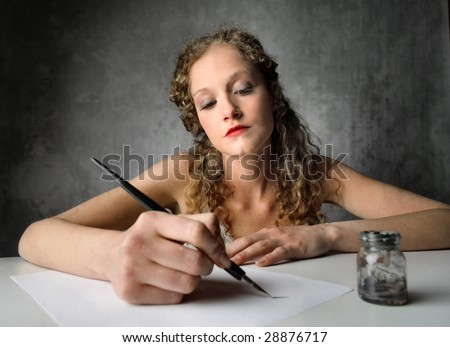 beautiful girl writing a letter - stock photo
