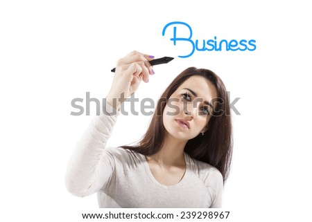 Beautiful girl writing with blue marker pen on virtual screen the world business. Young professional isolated on white background. - stock photo
