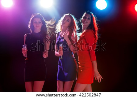 Beautiful girls dancing at the party - stock photo