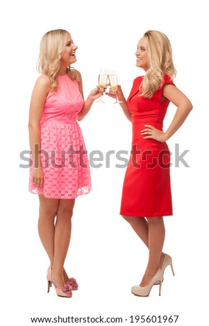beautiful girls in fashion dresses with champagne isolated on white  - stock photo