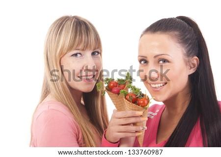 beautiful girls with ice cream of cherry tomato - stock photo