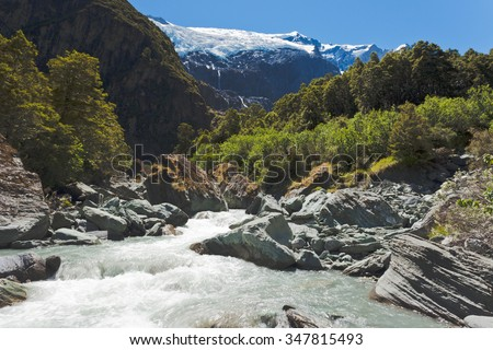 Beautiful glacial river running off hanging Rob Roy Glacier in Mount Aspiring National Park, Southern Alps, New Zealand - stock photo