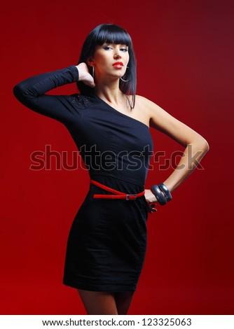 Beautiful glamorous female posing in a studio - stock photo