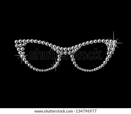 Beautiful, glamorous, retro cat glasses on black background. - stock photo