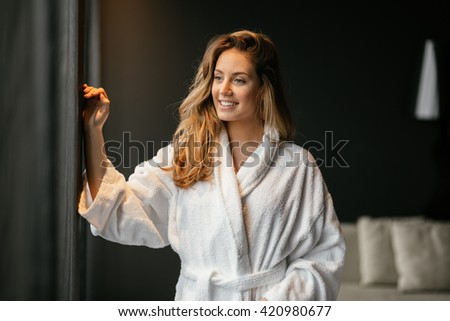 Beautiful glamorous woman in bathrobe enjoying wellness weekend - stock photo