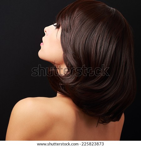 Beautiful glamour woman looking with nude back. Closeup - stock photo