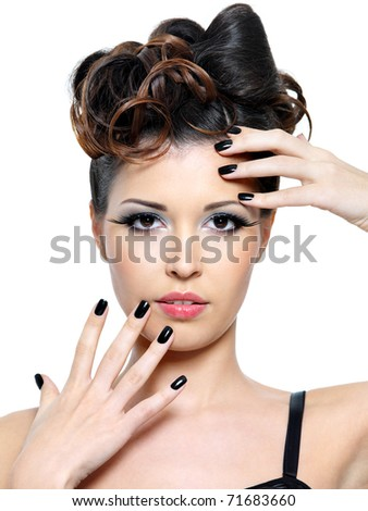 Beautiful glamour woman with modern hairstyle and black nails. Fashion eye make-up - stock photo