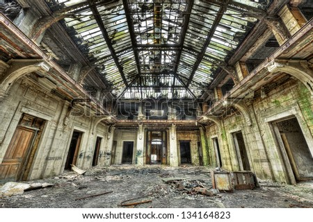 Beautiful glass roof inside the hall of an abandoned central office - stock photo