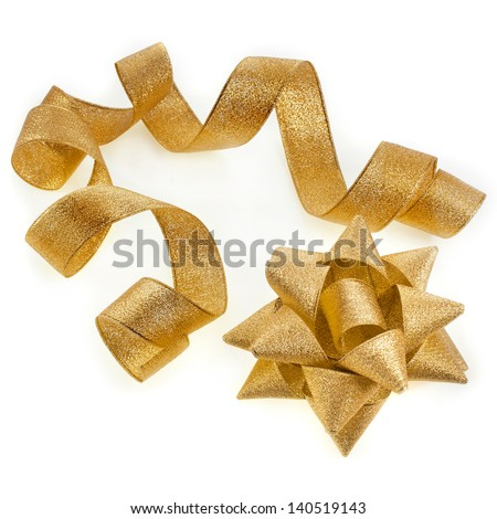 Beautiful glitter gold ribbon tape curl with bow isolated on white background - stock photo