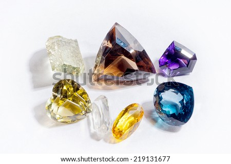 Beautiful glowing gems on a white background - stock photo