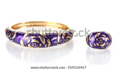 Beautiful golden bracelet and ring isolated on white - stock photo