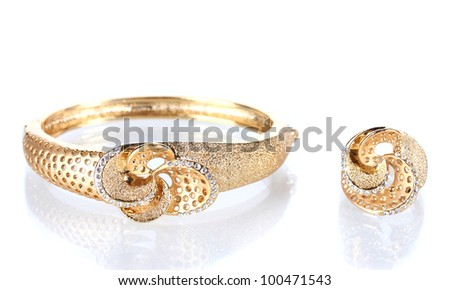 Beautiful golden bracelet and ring with precious stones isolated on white - stock photo
