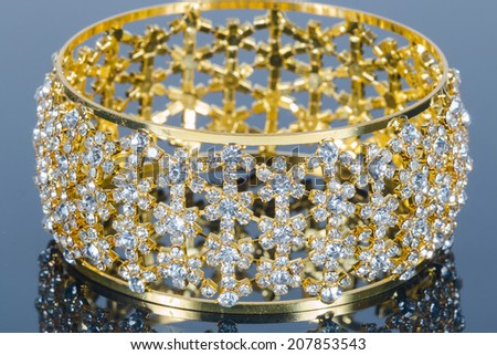 Beautiful golden diamond jewellery - stock photo