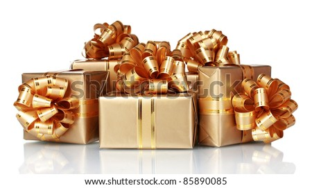 Beautiful golden gifts isolated on white - stock photo