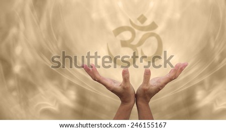 Beautiful Golden Om Healing Energy - Female healing hands reaching up towards a soft focus Om symbol on a pale golden energy formation background - stock photo
