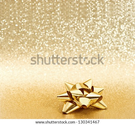 beautiful golden ribbon bow on shiny background - stock photo