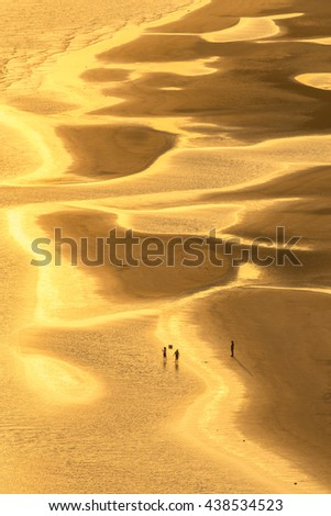 beautiful golden sunlight on tropical beach of Chao Laow with people walk on in Chanthaburi province in east of Thailand - stock photo