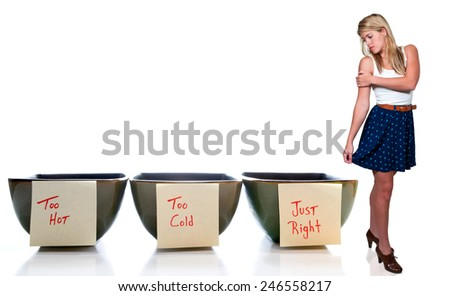 Beautiful Goldilocks woman with bowls of too hot, too cold and just right porridge - stock photo