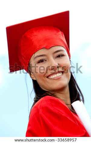 beautiful graduate female smiling in red gown - stock photo