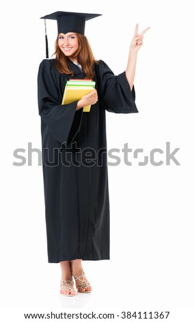 Beautiful graduate girl student in mantle with books showing victory sign, isolated on white background - stock photo