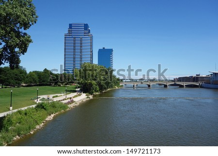 Beautiful Grand River in Grand Rapids, Michigan, with man-made rapids. - stock photo