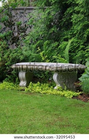 Beautiful granite bench in a park setting. - stock photo