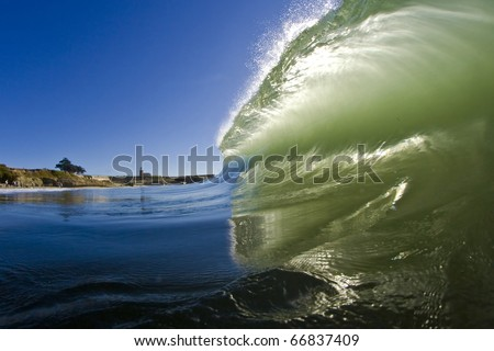 Beautiful green wave as viewed from the water - stock photo
