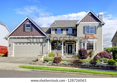 Beautiful grey new classic American home exterior with natural stone. - stock photo