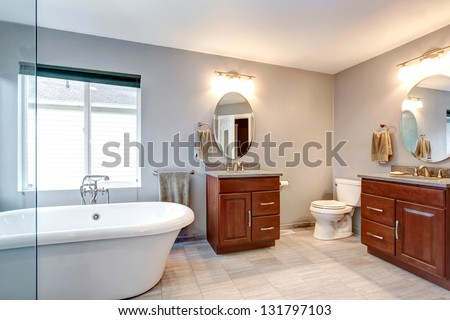 Beautiful grey new luxury modern bathroom interior with two separate sinks. - stock photo