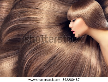 Beautiful Hair. Beauty woman with luxurious long hair as background. Beauty Model girl with Healthy blond Hair. Beautiful woman with long smooth shiny straight hair. Hairstyle. Hair cosmetics - stock photo