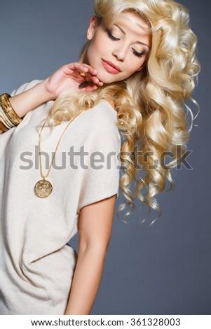 beautiful hair. long curly blond hair. Portrait of beautiful blonde woman. beautiful blonde woman with perfect curly hair. Blonde Hair. Portrait of Beautiful Woman with Long Wavy Hair.  - stock photo