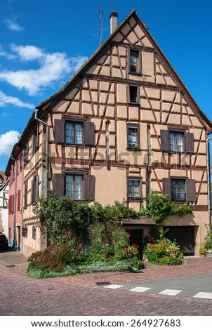 Beautiful half-timbered houses with red tiled roofs in the historic center of Selestat in Alsace. France - stock photo