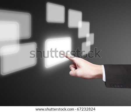 Beautiful hand pushing a button on a touch screen - stock photo