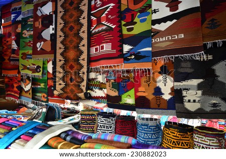 Beautiful handcrafted goods, carpets on the market in Otavalo, Ecuador - stock photo