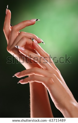 beautiful hands and nails of a young girl - stock photo