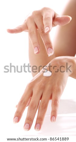 Beautiful hands with french manicure against white background - stock photo