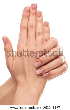Beautiful hands with french manicure on white background - stock photo