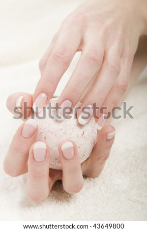 Beautiful hands with healthy skin and perfect fresh french manicure - stock photo