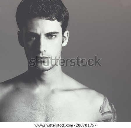 Beautiful (handsome) muscular male model with nice body. Close up. Studio portrait - stock photo