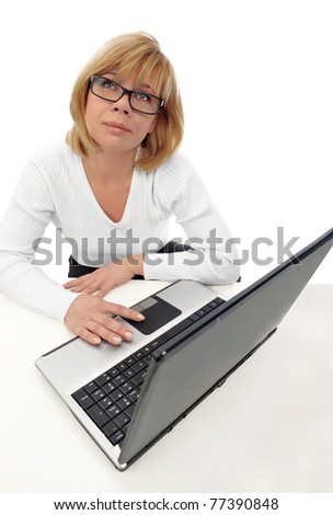 Beautiful happy and smiling business woman working on computer at her office against white wall wearing glasses - stock photo