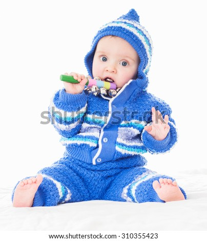 Beautiful happy baby in a blue dress . One,isolated on white. - stock photo