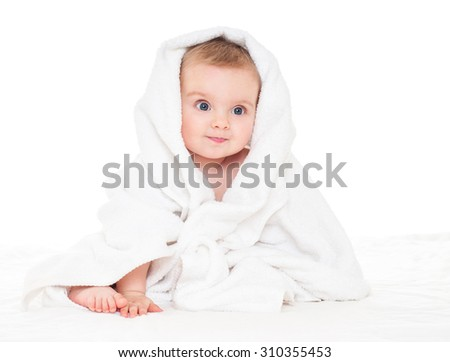 Beautiful happy baby  in a towel after bath. One, isolated on white. - stock photo