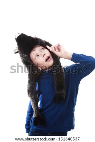 Beautiful happy blond boy wearing a funny animal costume pointing his index finger upwards (isolated on white background) - stock photo