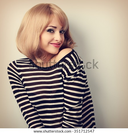 Beautiful happy blond woman with short hair style posing and looking with smile. Vintage portrait - stock photo