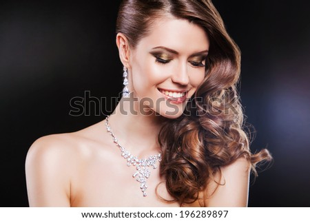 beautiful happy brunette woman with luxury accessories. - stock photo