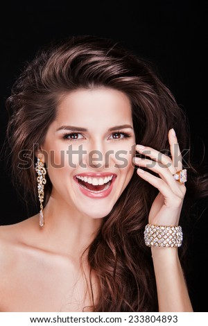 beautiful happy brunette woman with luxury earring and necklace - stock photo